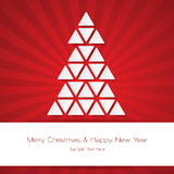 Merry Christmas and Happy New Year over red color burst background. Royalty Free Stock Image