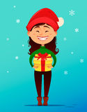 Merry Christmas and Happy New Year postcard. Cute smiling girl in Christmas hat holding gift box in her handsб full height. Vector illustration. Design Royalty Free Stock Photography