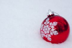 Merry Christmas and Happy New Year. Red Christmas ball snow winter Royalty Free Stock Photos