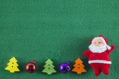 Merry Christmas and Happy New Year,Santa Claus and Christmas trees on green background Royalty Free Stock Photo