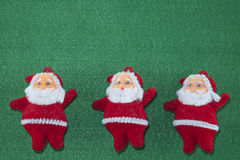 Merry Christmas and Happy New Year,Santa Claus and Christmas trees on green background Royalty Free Stock Image