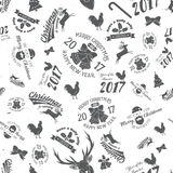 Merry Christmas and Happy New Year 2017 seamless pattern. Vector illustration. Xmas retro wallpaper Royalty Free Stock Photos