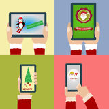 Merry Christmas and Happy New Year with smartphone and tablet Royalty Free Stock Photo
