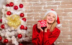 Merry christmas and happy new year. Smiling woman celebrating christmas. New year party. happy girl in santa claus hat