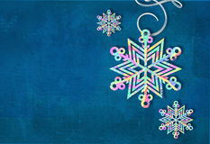 Merry Christmas and happy new year snowflake made with colorful triangles background. Christmas festive card. Stock Images