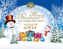 Merry Christmas and a Happy New Year with snowman and gift boxes Stock Photo