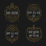 Merry Christmas and Happy New Year text. Art deco badges in outline style. 2017 Xmas card in golden colors Stock Photos