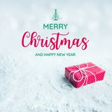 Merry christmas and happy new year text with gift box,present. On snow background.For festival and celebration concepts ideas.Top view Royalty Free Stock Image