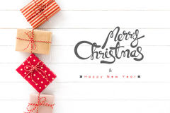 Merry Christmas and Happy New Year text with gift boxes on white Stock Photos