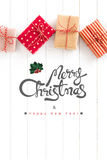 Merry Christmas and Happy New Year text with gift boxes on white Royalty Free Stock Images