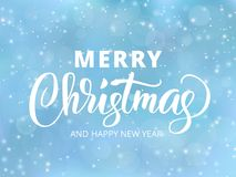Merry Christmas  and Happy New Year text. Holiday greetings quote. Blue blurred background with falling snow effect. Stock Images