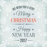 Merry Christmas and Happy New Year 2017. Merry Christmas and Happy New Year 2017 text label on a winter background with snow and snowflakes. Greeting card Royalty Free Stock Photos