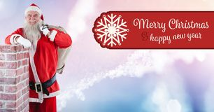 Merry Christmas Happy New Year text and Santa with sack by chimney Stock Photo
