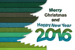 Merry christmas and happy new year text on tree Stock Photo