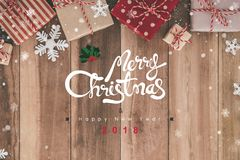 Merry Christmas and Happy New Year 2018 texts above wood table. With snow falling - can be used for display or montage your products Royalty Free Stock Photos
