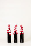 Merry Christmas and happy New year. Three bottles of wine in kni Stock Photo