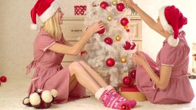 Merry christmas and Happy new year. Two blonde girls and Christmas decorations. Merry christmas and Happy new year. Two blonde girls and Christmas decorations stock footage