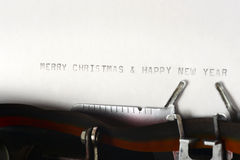 Merry Christmas And Happy New Year Typing Stock Photo