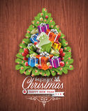 Merry Christmas and Happy New Year typographic design with holiday elements on wood texture background. Royalty Free Stock Photos