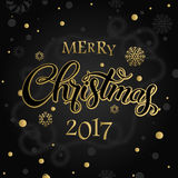Merry Christmas and happy new year 2017. Vector lettering on black background whit snowflake and gold dots on poster. Isolate font golden decor Stock Photos