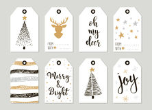 Merry Christmas and Happy New Year vintage gift tags cards with calligraphy. Merry Christmas and Happy New Year vintage gift tags and cards with calligraphy Stock Photo