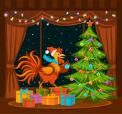 Merry Christmas and Happy New Year 2017 winter card background with cute funny Rooster. Standing on presents holding ball decorating xmas tree Stock Image