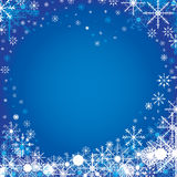 Merry Christmas and Happy New Year in winter. The colorful snow in sky on blue background. Stock Photo