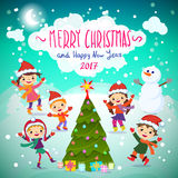 Merry Christmas And Happy New Year. 2017. Winter fun.. Winter fun. Cheerful kids playing in the snow Royalty Free Stock Image