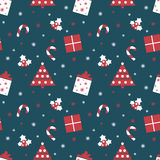 Merry Christmas and Happy New Year. Winter holiday background. Cute seamless pattern with red and blue colors. Stock Photos