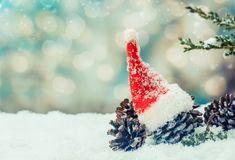 Merry Christmas and Happy New Year. Winter season. Decoration on snow Santa red hat Royalty Free Stock Photo