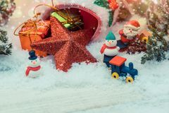 Merry Christmas and Happy New Year decoration. Merry Christmas and Happy New Year, winter season. Decoration on snow. Snowman and Santa Royalty Free Stock Photo
