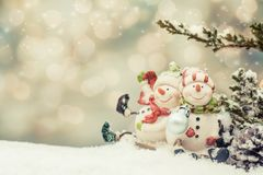 Merry Christmas and Happy New Year. Winter season. Decoration on snow with snowman toy Stock Photography