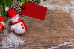 Merry Christmas and Happy New Year, winter season. Price tag with copy space for text on wood background Stock Photography