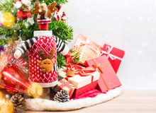 Merry Christmas and Happy New Year decoration. Merry Christmas and Happy New Year, winter season. Red wine with gift boxes for party Stock Photos