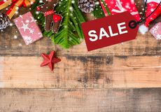 Merry Christmas and Happy New Year, winter season. Sale on price tag and wood background with copy space for text Stock Photography