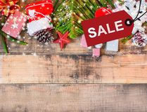 Merry Christmas and Happy New Year. Winter season. Sale tag on wood background and copy space for text Stock Photo