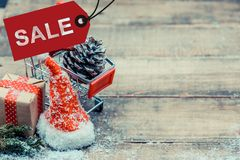 Merry Christmas and Happy New Year. Winter season with snow and decoration. Shopping on sale Boxing day stock photography