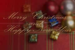 Merry Christmas and Happy New Year Wishes with Blurred Ornaments royalty free stock photo