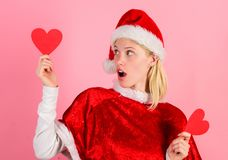 Merry christmas and happy new year. Woman hold heart symbol of love. Bring love to family holiday christmas. I love. Christmas. Girl happy wear santa costume stock images