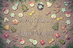Merry Christmas and Happy New Year! written among gingerbread cookies. Stock Images