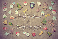 Merry Christmas and Happy New Year! written among gingerbread cookies. Royalty Free Stock Image