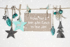 Merry christmas and a happy new year: xmas card with german text. Merry christmas card in white, grey and turquoise color and a happy new wishes:  xmas card with Royalty Free Stock Image