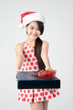 Merry christmas and happy new year. Happy young asian girl in christmas hat with presents Stock Image