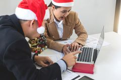 Merry Christmas and Happy New Year, Young business team are cele Royalty Free Stock Photo