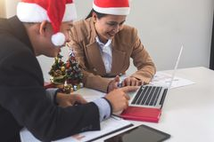 Merry Christmas and Happy New Year, Young business team are cele Stock Images