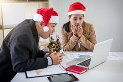 Merry Christmas and Happy New Year, Young business team are cele Royalty Free Stock Photos