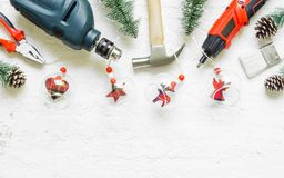 Merry Christmas and Happy New Years Handy Constrcution Tools background concept. Handy House Fix DIY handy tools with Christmas royalty free stock photography