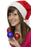 Merry Christmas, happy teenager with Christmas tre Stock Photography