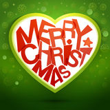 Merry christmas heart message at green backdrop Royalty Free Stock Photos