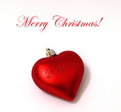 Merry Christmas heart ornament. A red christmas heart shaped ornament, with Merry Christmas title Stock Photography